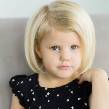 Little girl on a couch for children photography in Utah.