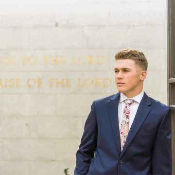 An LDS missionary standing out front of the Salt Lake LDS temple for missionary photography in Utah.