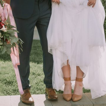 The feet of a bride and groom for wedding photography in Utah.