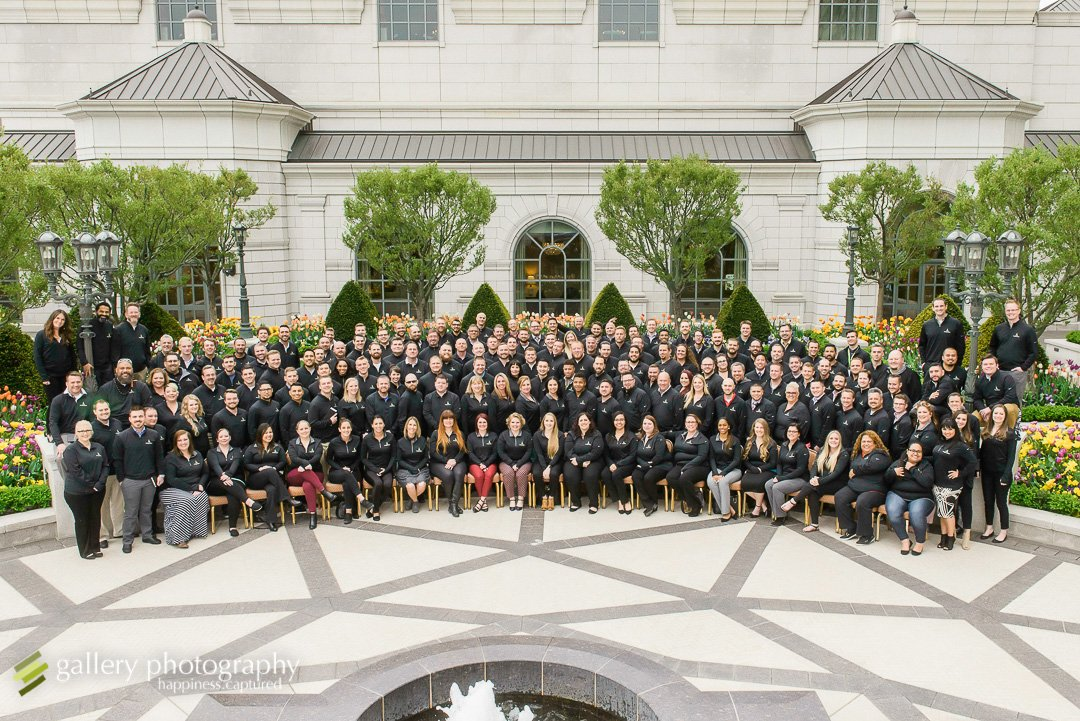A group photo of over one hundred members of staff for Bountiful commercial photography.