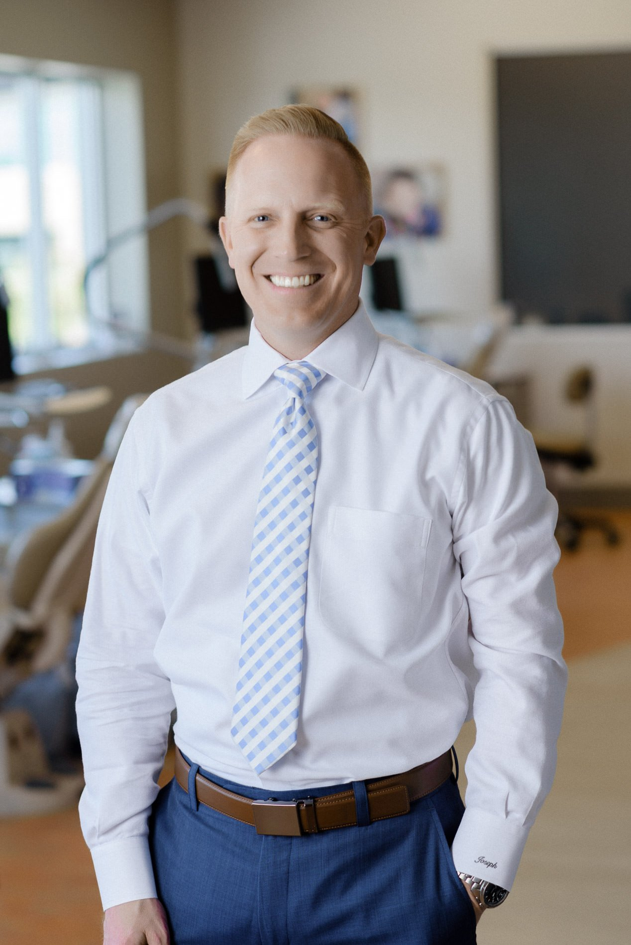 An image of an orthodontist in his office for Bountiful commercial photography.