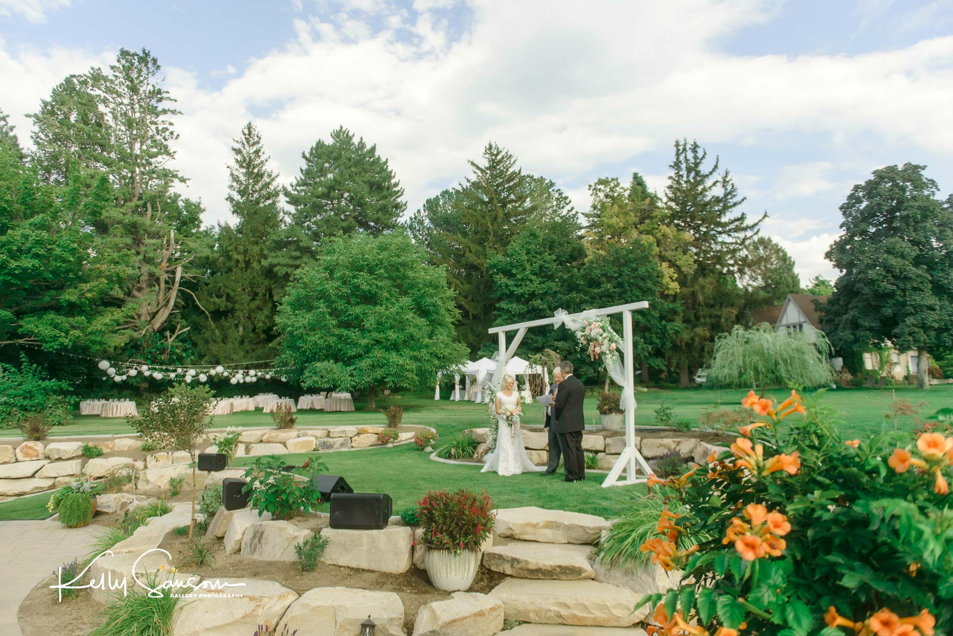 Couple being married in a beautiful yard for Bountiful Utah photography.