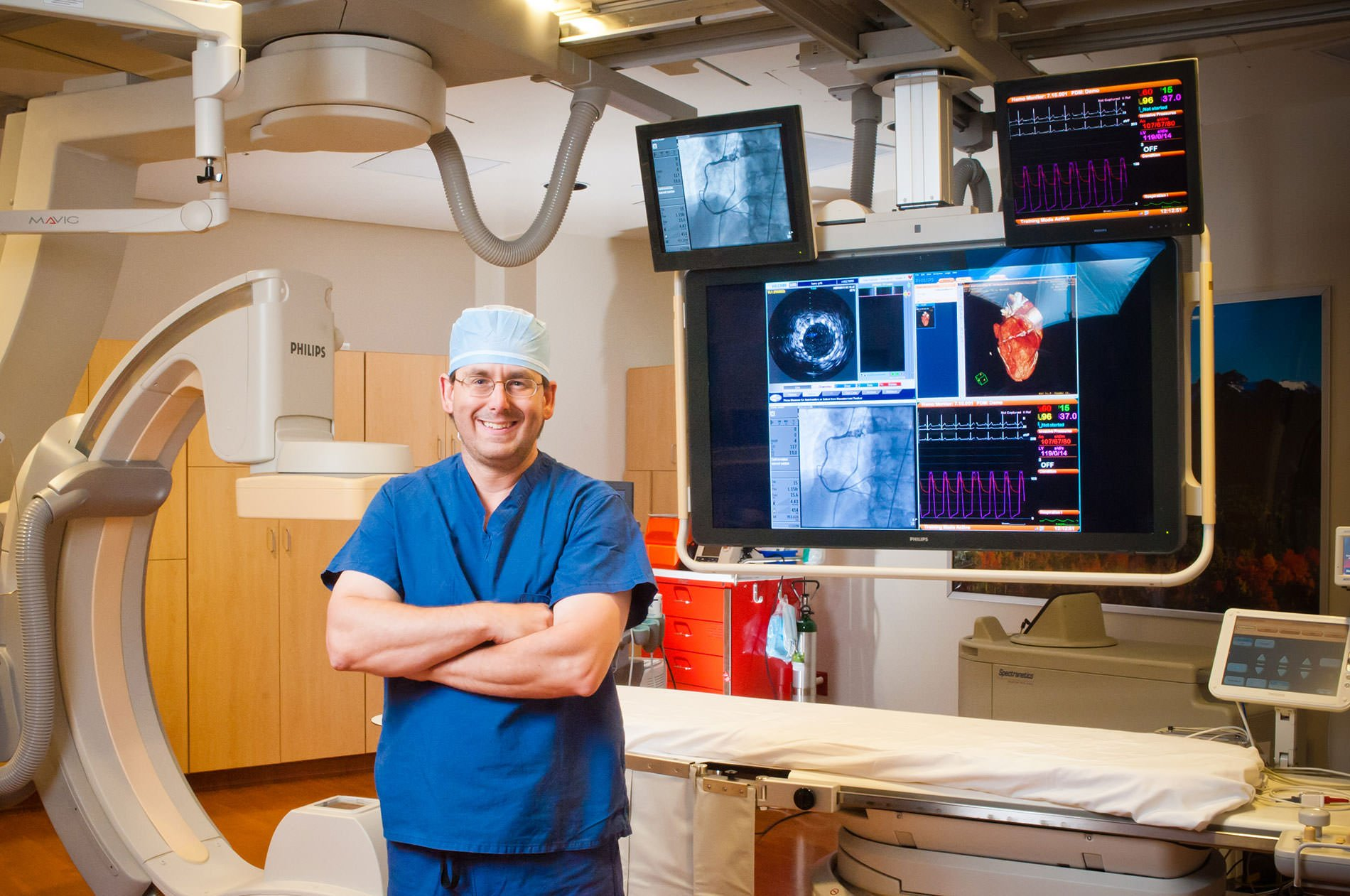 Doctor in a Cath lab posing smiling at the camera for Ogden commercial photography.