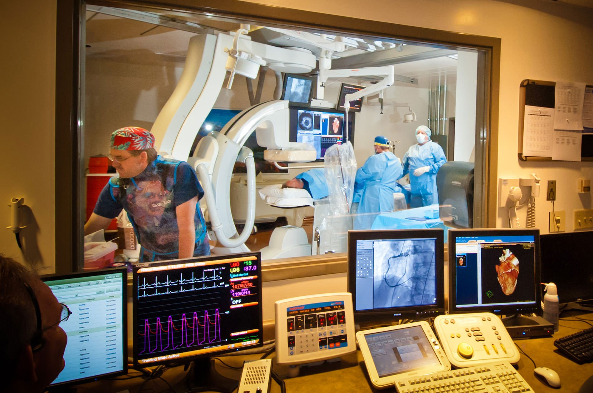 Workers in a Cath lab working on a patient for Ogden commercial photography.