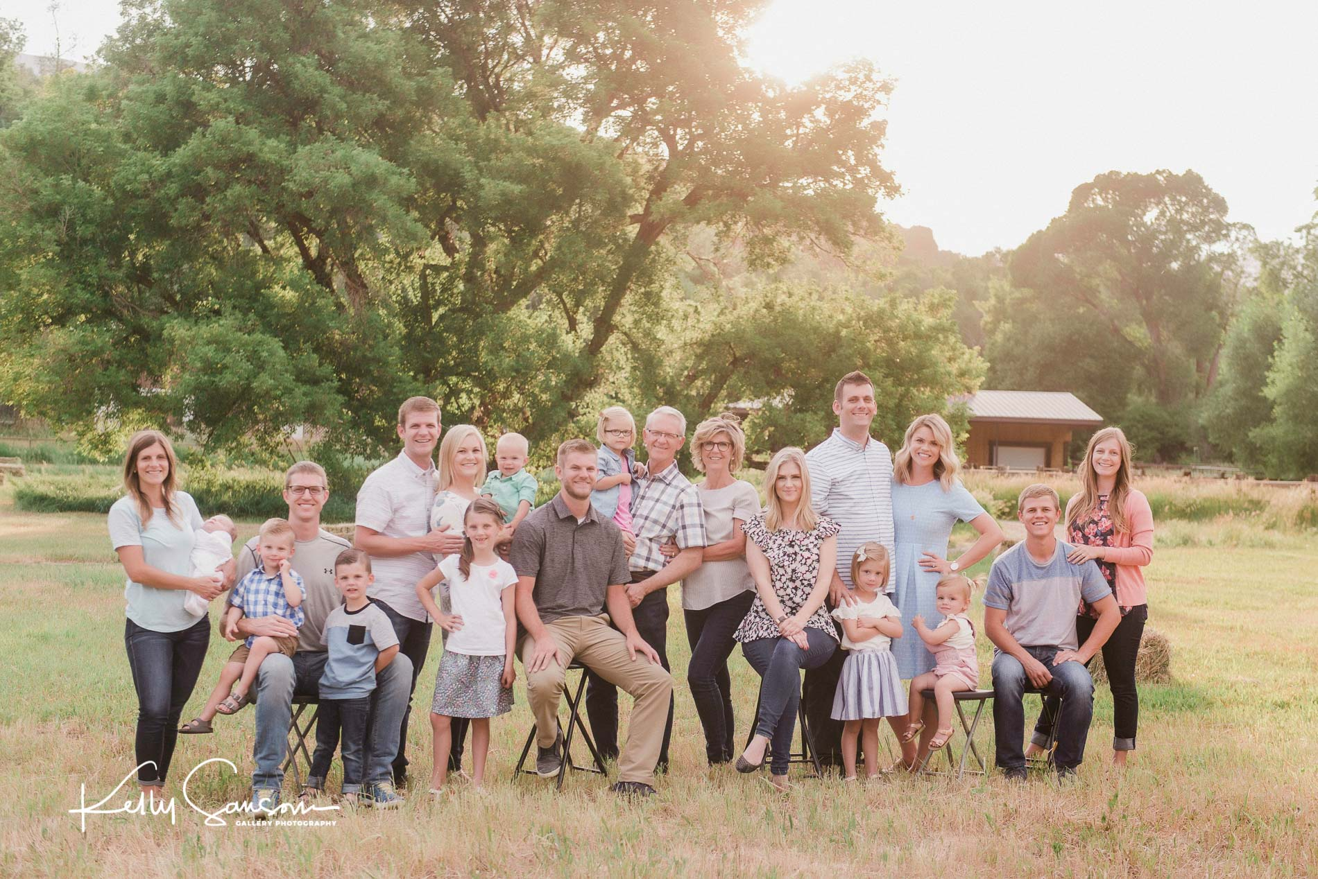 A Large family group with barn behind for Ogden family photography.