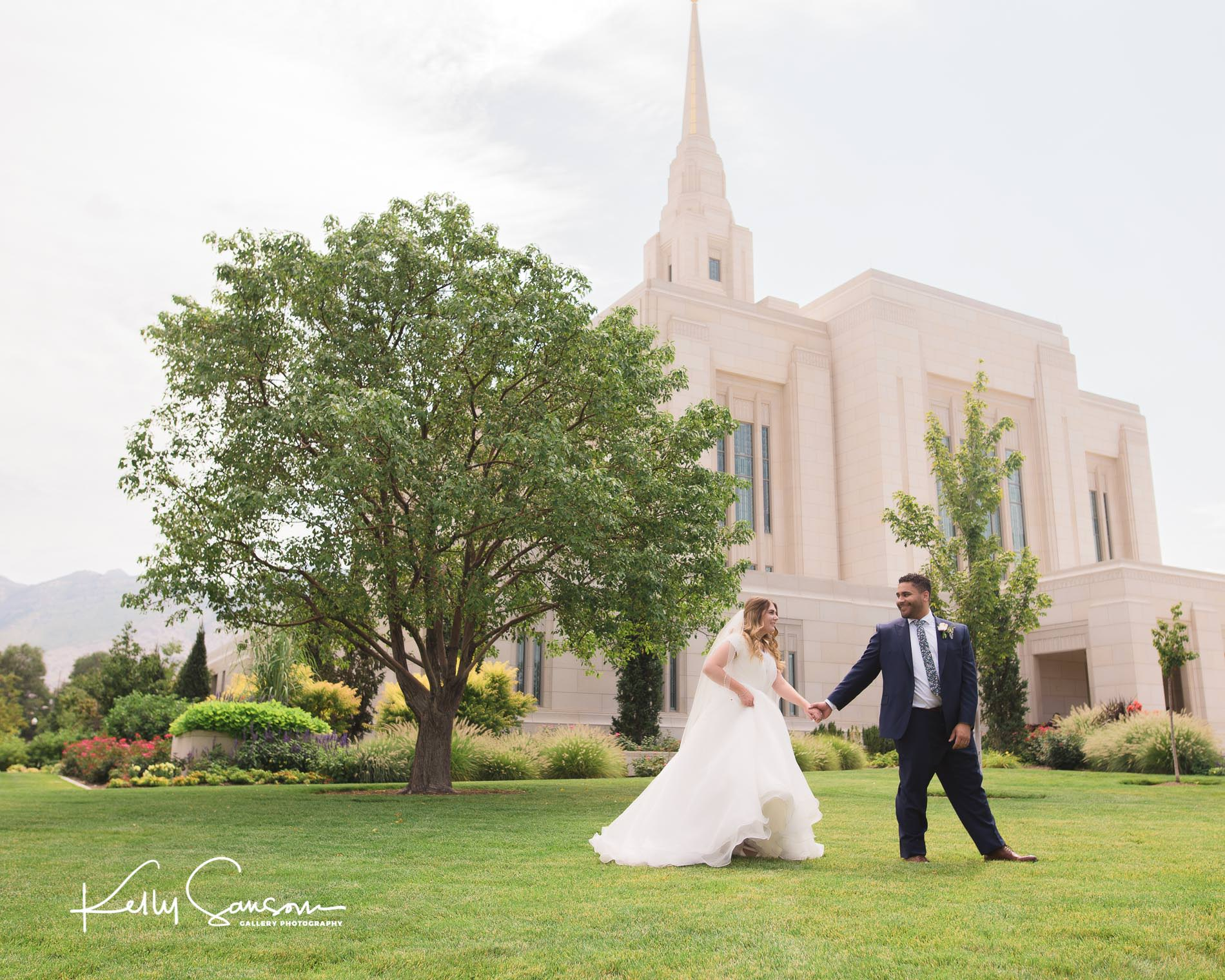 A bride and groom walking together in front of the Ogden LDS temple for Ogden Utah Photography.