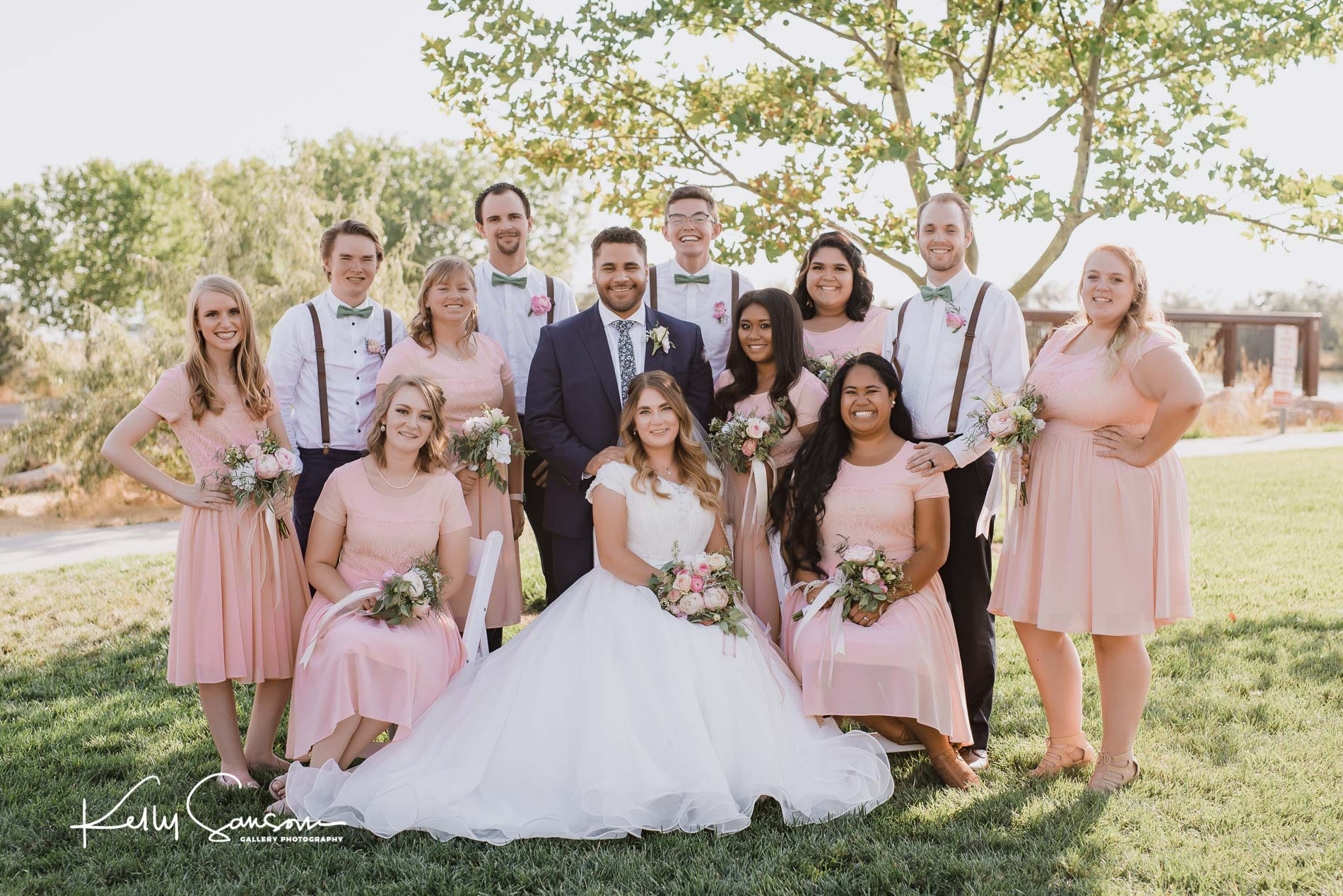 A wedding group posed in front of pond for Ogden Utah photography.