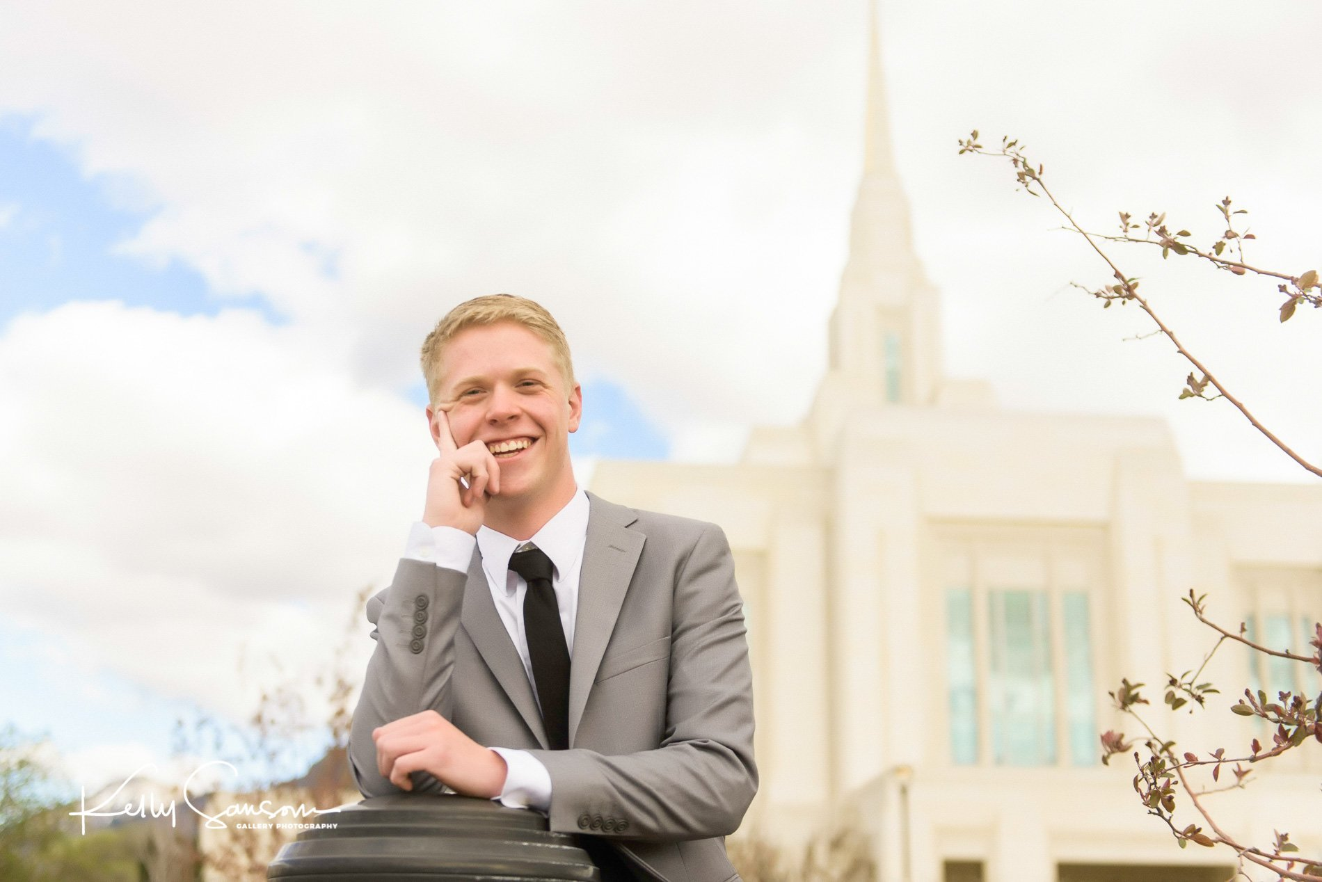 A young man standing in front of the Ogden LDS temple for Ogden portrait photography.