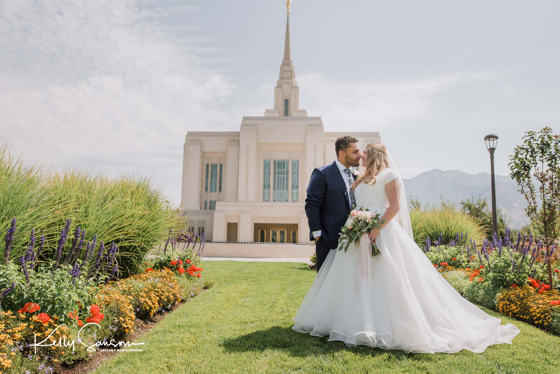 A bride and groom touching faces in front of the Ogden LDS temple for Ogden wedding photography.