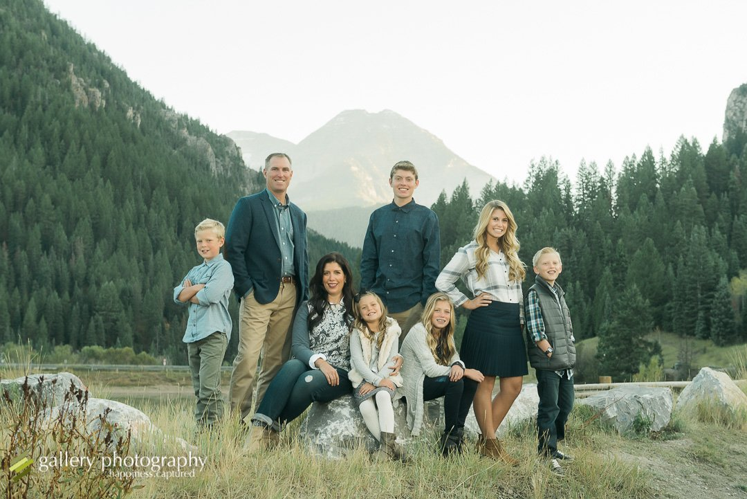 Family portrait next to pine trees and with mt tipanogos in the background for family photography at Tibble Fork.