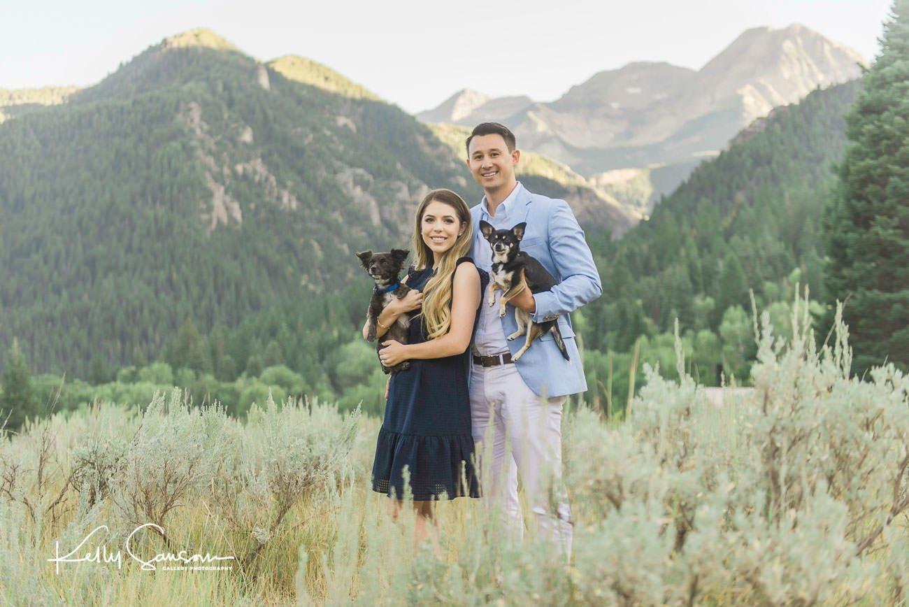 A couple and their two dogs with Mt Timpanogos in the background for family photography at Tibble Fork.