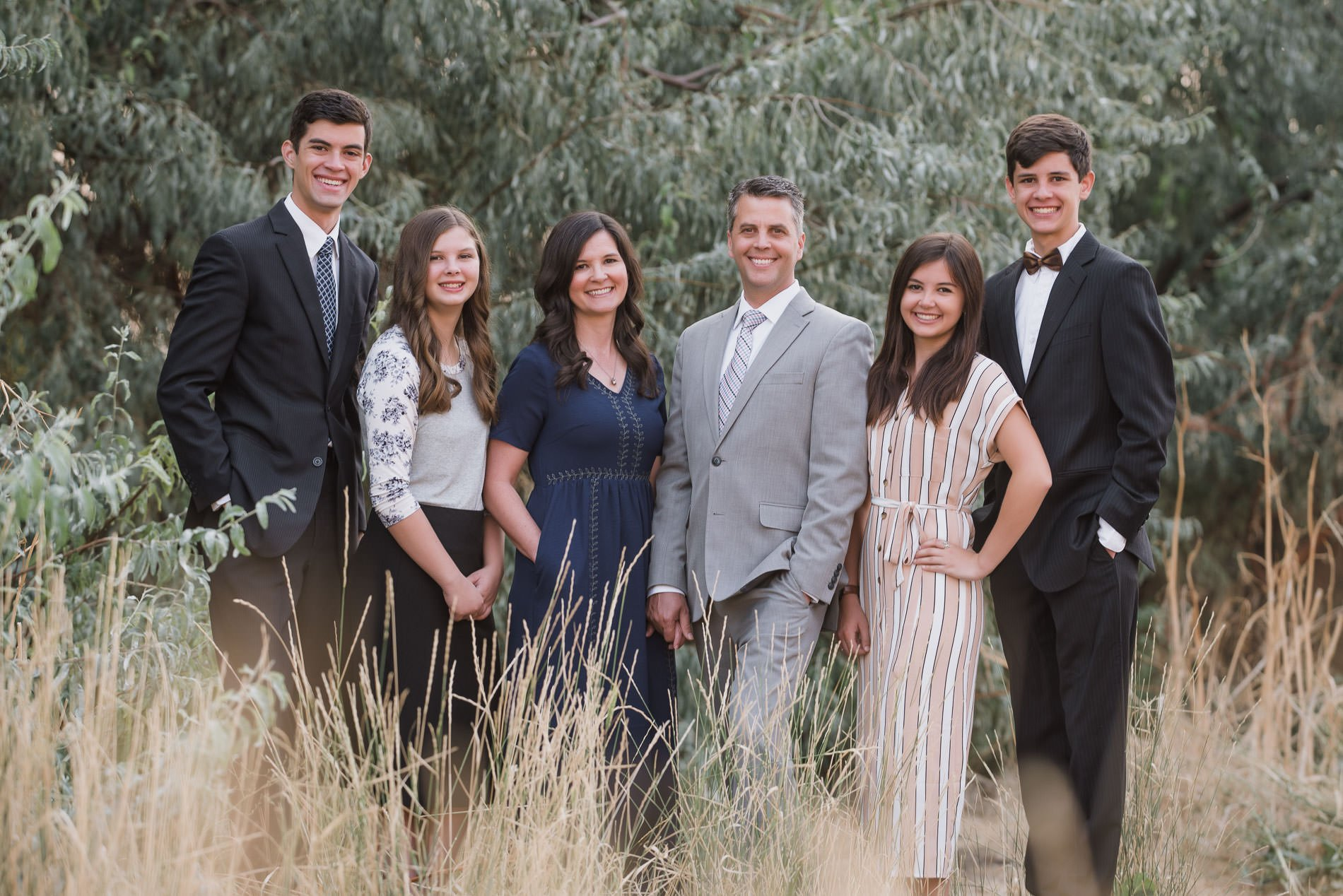 Dressy family portrait by the Russian olive trees in family photography at tunnel springs park.