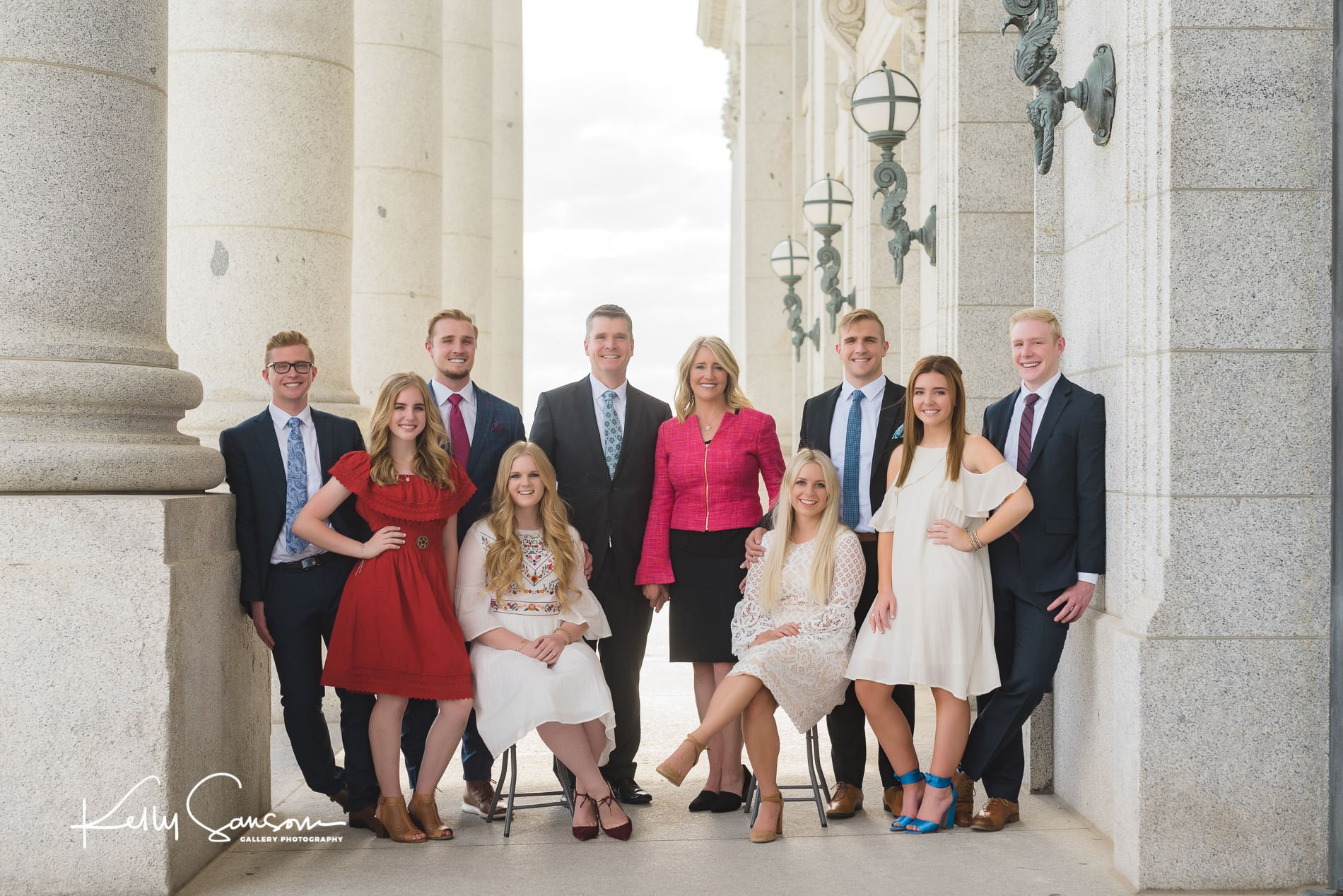A family dressed formally for family photography at the utah state capitol
