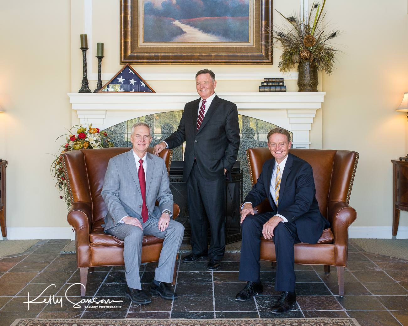 Three principles of a business seated for Salt Lake City commercial photography.