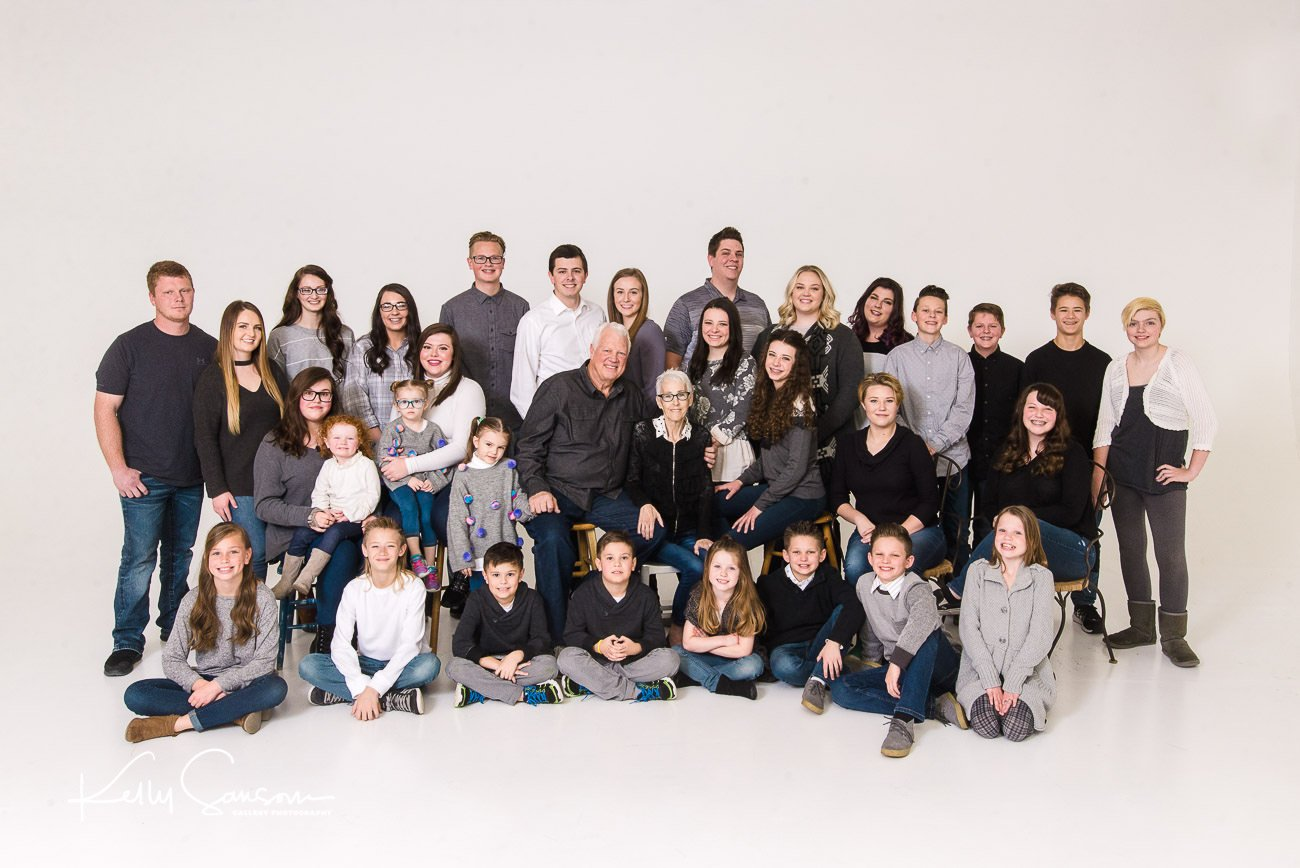 A large family group in the studio for Salt Lake City family photography.