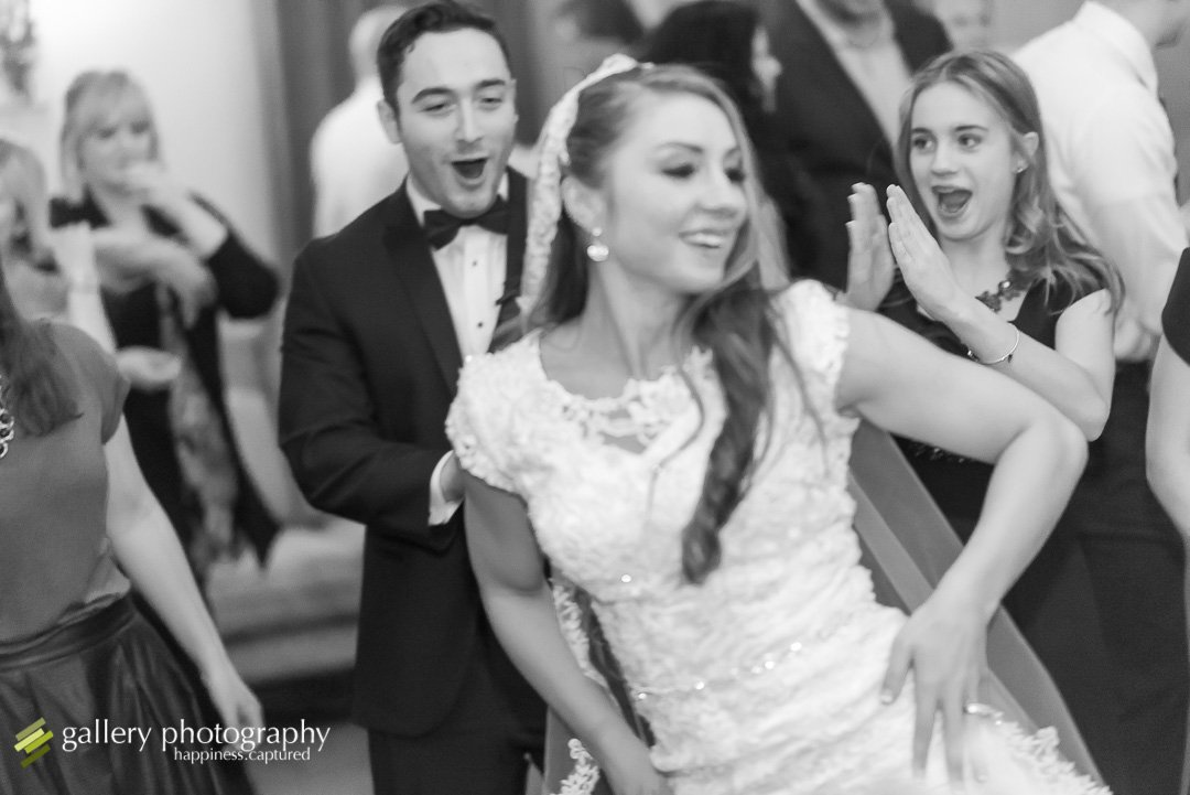 A bride dancing with her groom for their wedding for Salt Lake City wedding photography.