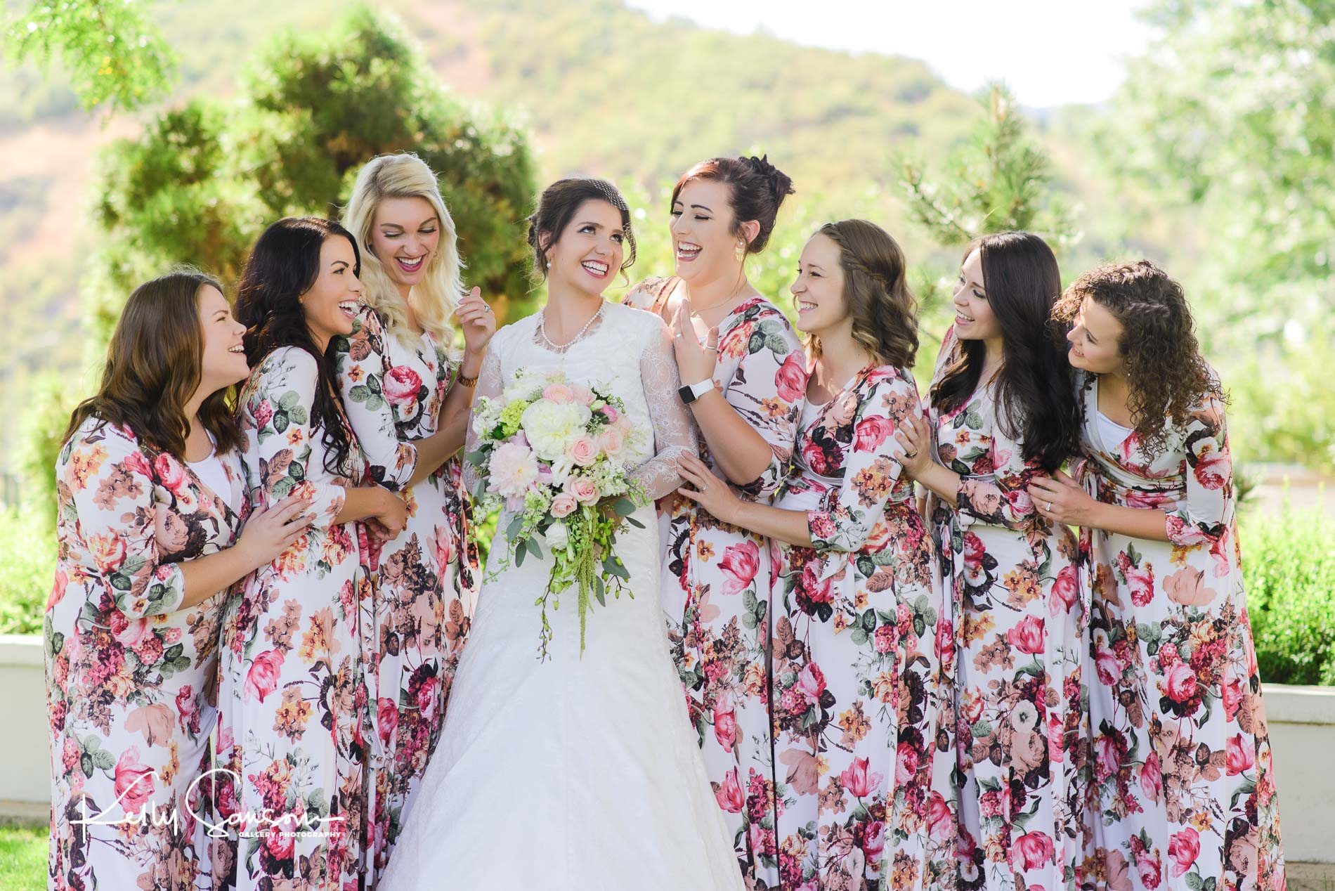 Bridesmaids laugh with a bride for wedding photography at the Bountiful LDS temple.