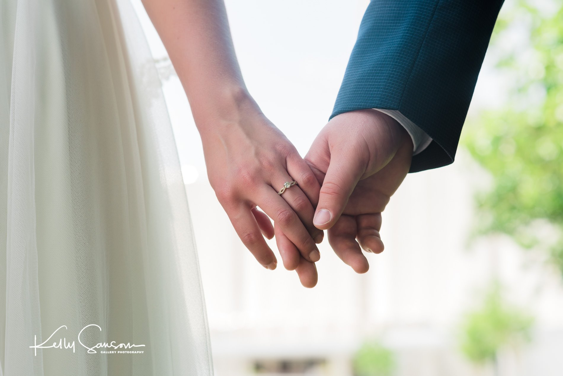 A bride and groom hold hands for Jordan river temple wedding photography.