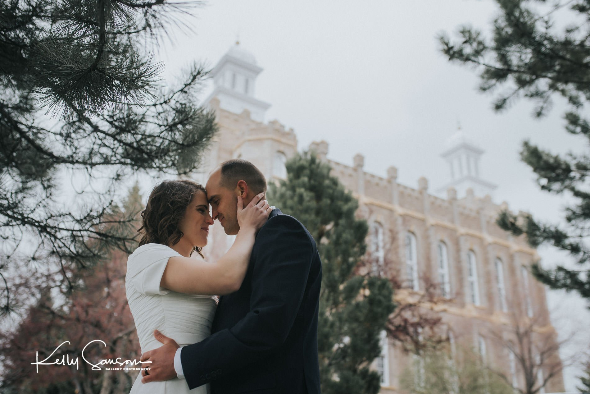 A bride and groom touching heads together and loving for Logan temple wedding photography.