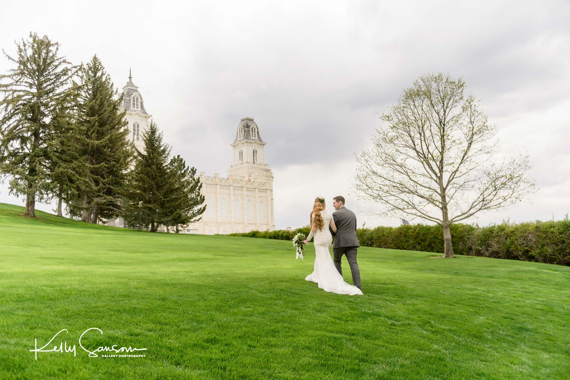 A bride and groom walk towards the Manti temple for Manti temple wedding photography.