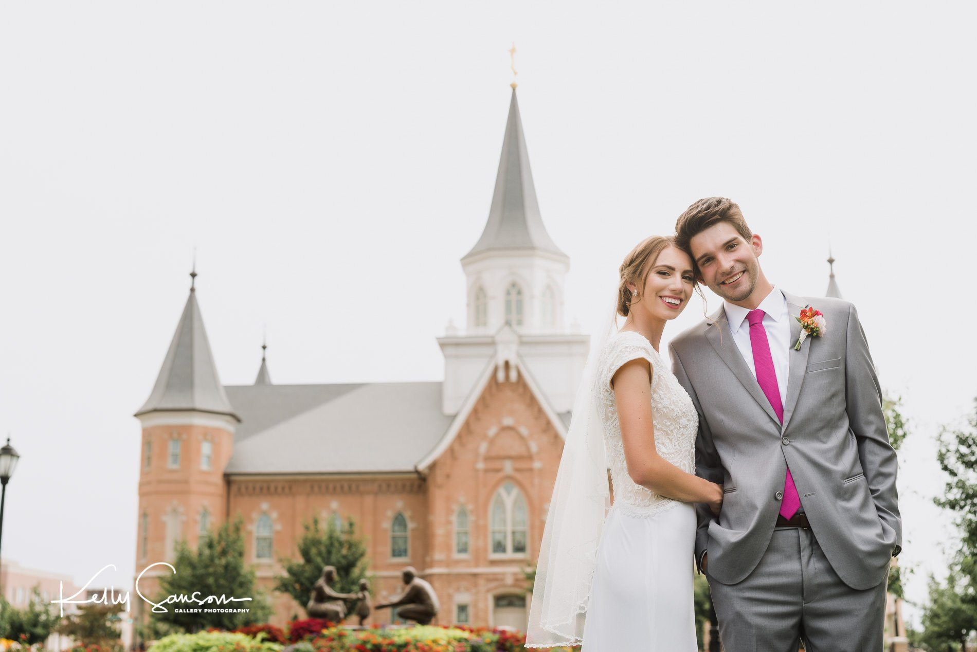 Bride and groom touching heads together looking at camera for wedding photography at provo city center lds temple.